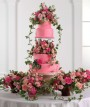 """Tiered pink fondant cake with Bridesmaid Baskets"""